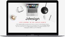 macbook ouvert avec dans l'ecran le site www.jdesign.fr